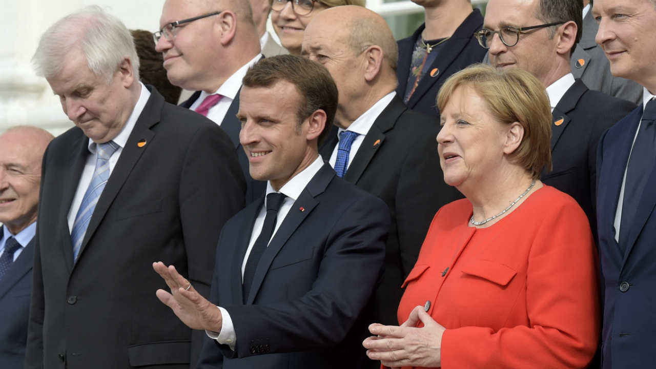 German Interior Minister Horst Seehofer, France's President Emmanuel Macron and German Chancellor Angela Merkel, from left, pose for a photo after a meeting in the guest house of the German government in Meseberg north of Berlin, Germany. (AP/PTI)