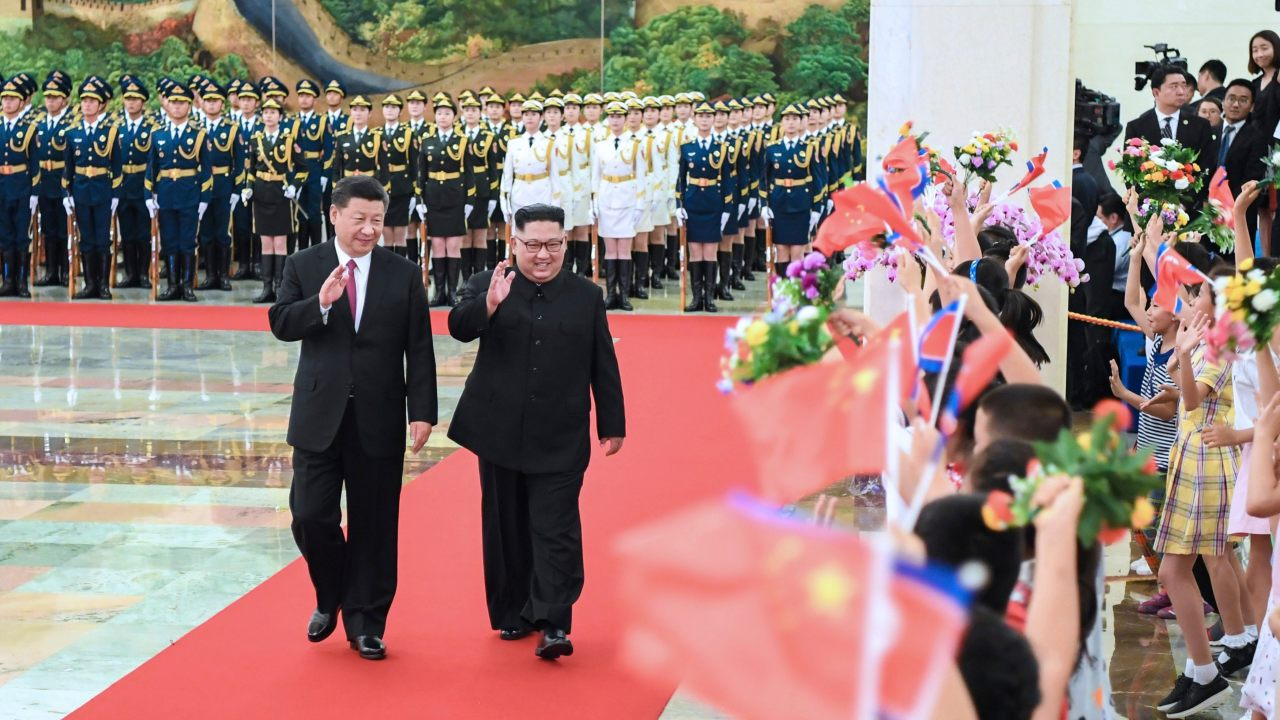 In this photo provided by China's Xinhua News Agency, Chinese President Xi Jinping, left, North Korean leader Kim Jong Un, right, walk together during a welcoming ceremony for Kim at the Great Hall of the People in Beijing. (Image: AP/PTI)