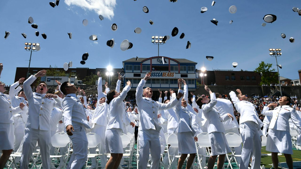 New ensigns toss their cadet covers into the air upon graduation from the United States Coast Guard Academy in New London. (Image: AP/PTI)