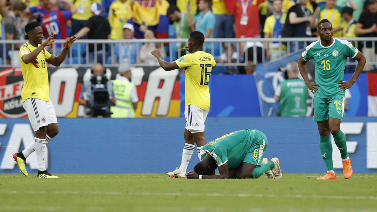Colombia's Yerry Mina, left, and team mate Jefferson Lerma celebrate while Senegal's Mame Diouf lies on the ground besides team mate Diafra Sakho after the group H match between Senegal and Colombia, at the 2018 soccer World Cup in the Samara Arena in Samara, Russia. (AP/PTI)