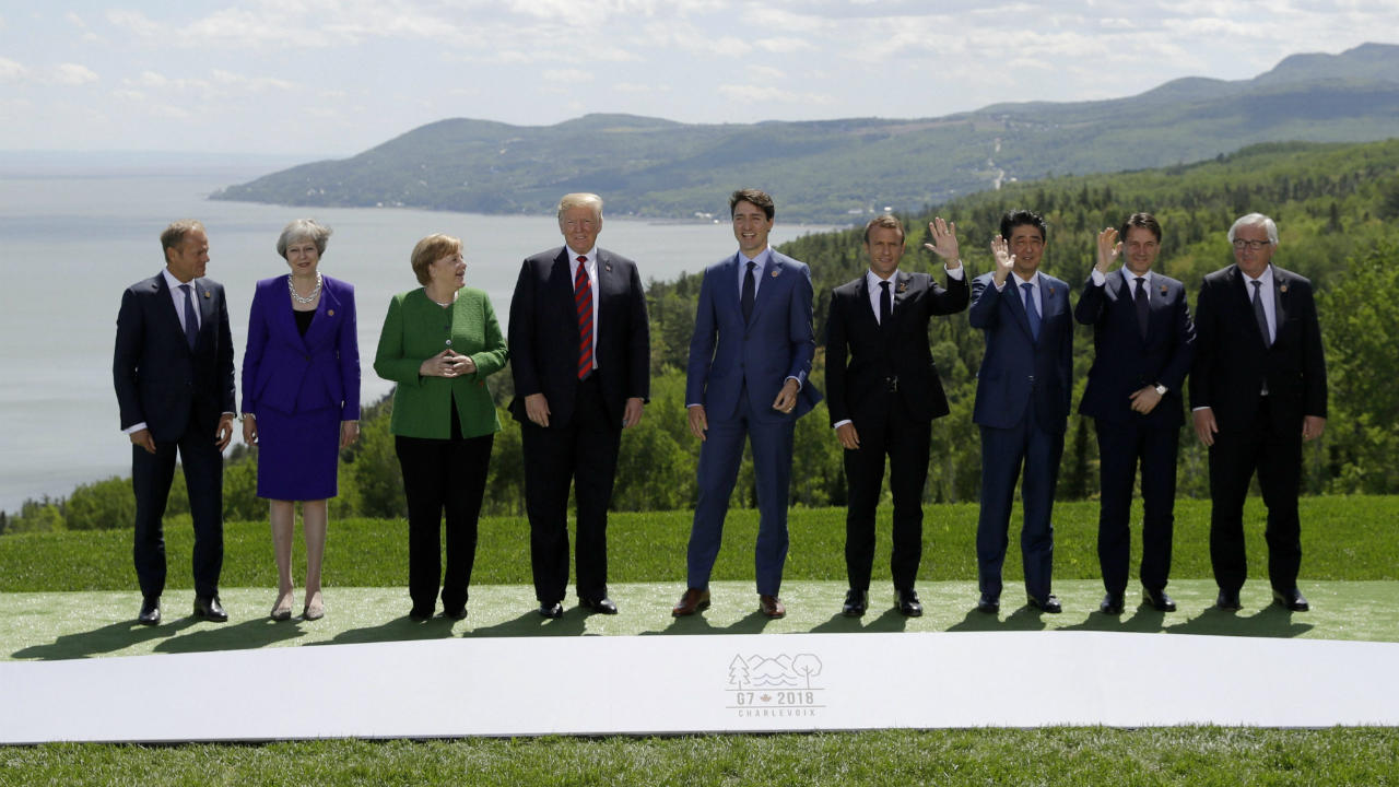 (From left) President of the European Council Donald Tusk, British Prime Minister Theresa May, German Chancellor Angela Merkel, US President Donald Trump, Canadian Prime Minister Justin Trudeau, French President Emmanuel Macron, Japanese Prime Minister Shinzo Abe, Italian Prime Minister Giuseppe Conte and President of the European Commission Jean-Claude Juncker gather for the family photo at the G7 summit in Charlevoix, Canada. (Image: AP/PTI)