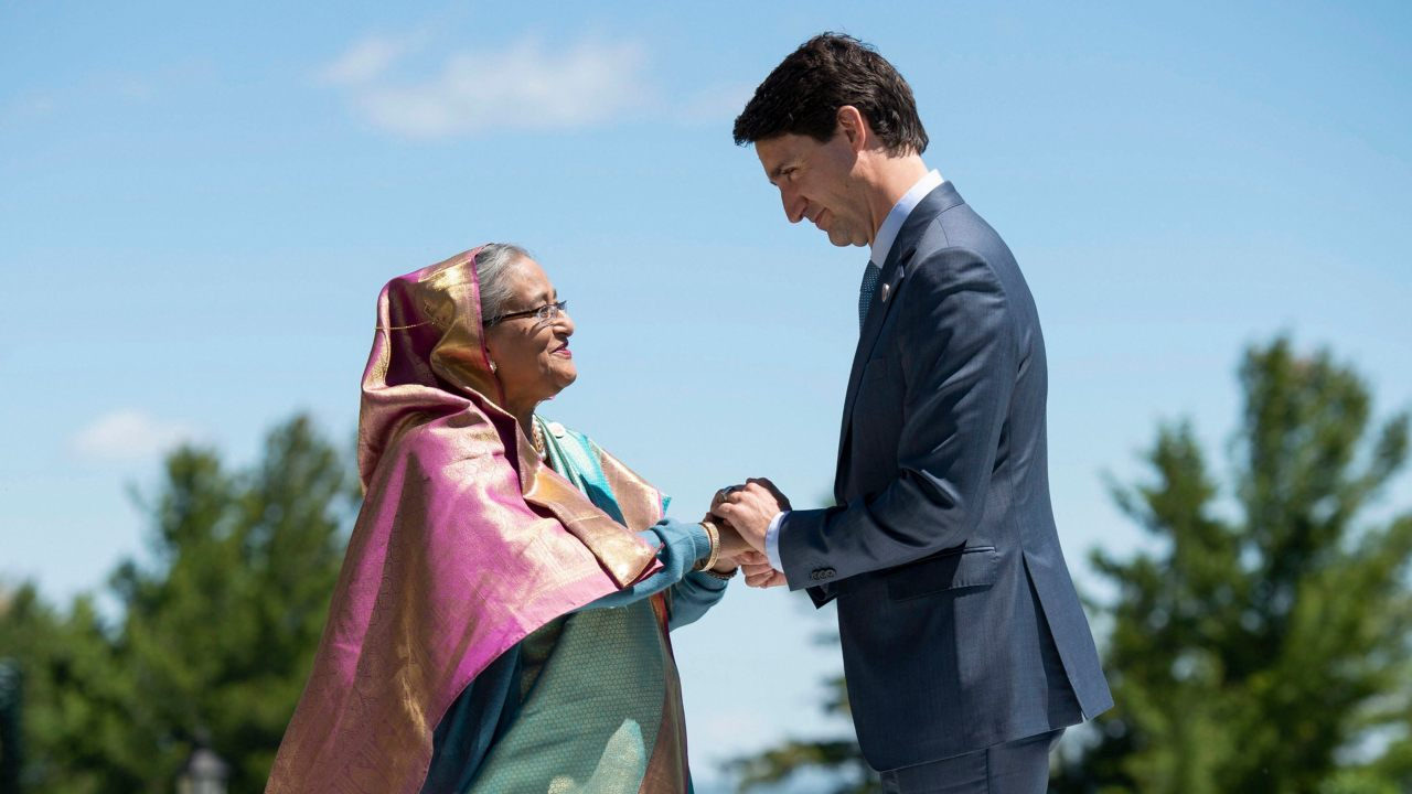 Canada's Prime Minister Justin Trudeau shakes hands with Bangladesh's Prime Minister Sheikh Hasina as he welcomes representatives from outreach countries and international organizations during the G-7 summit in La Malbaie, Quebec. (Image: AP/PTI)