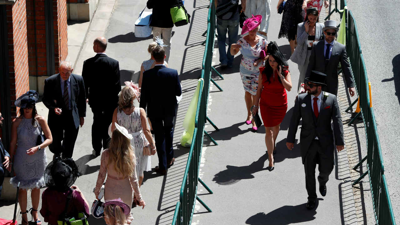 Racegoers arrive at Ascot Racecourse, England before the start of the horse racing. (Photo: Reuters)