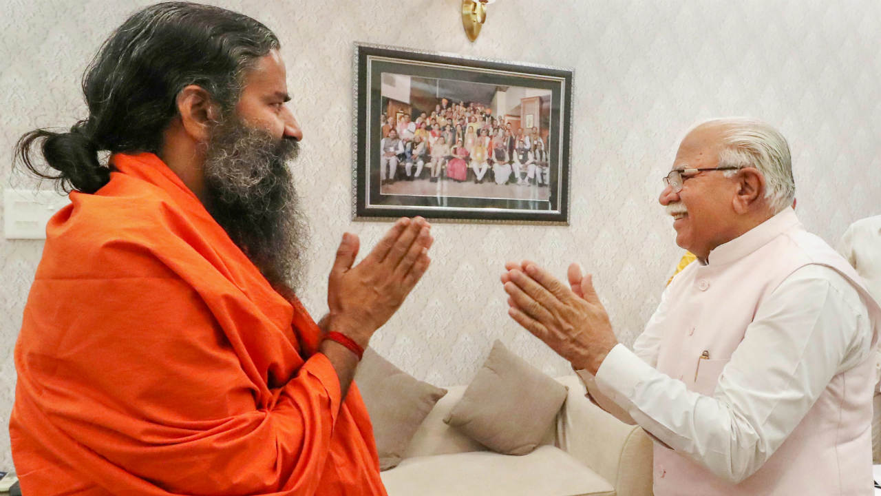 Haryana Chief Minister Manohar Lal Khattar greets Yoga guru Baba Ramdev during a meeting in Chandigarh. (Photo: PTI)