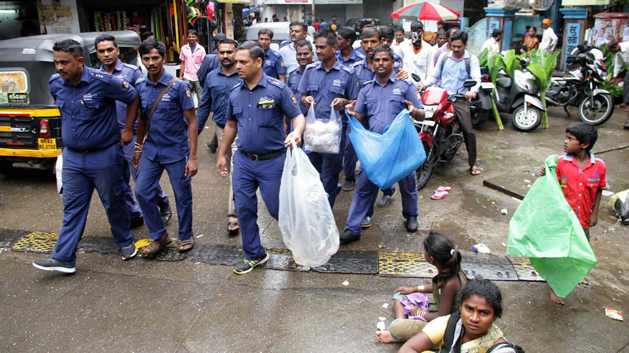 Civic workers inspect the shops following a plastic ban in Thane. (Photo: PTI)