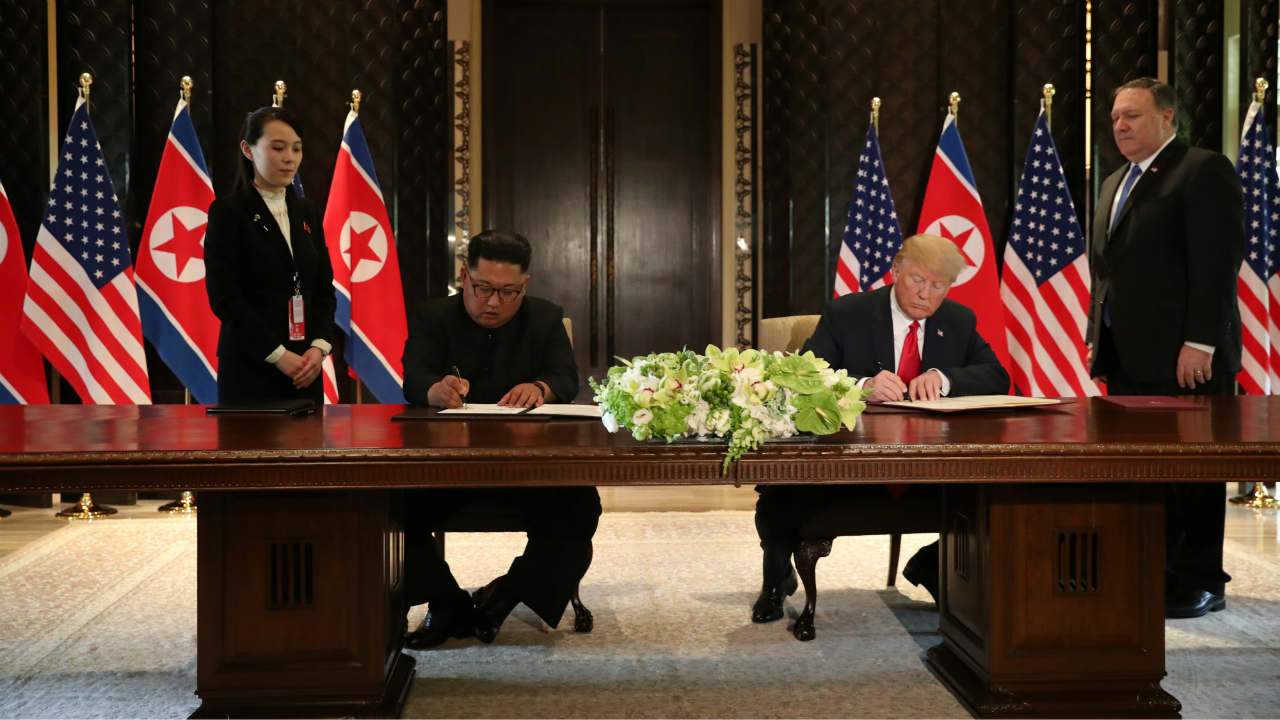 US President Donald Trump and North Korea's leader Kim Jong Un sign documents that acknowledge the progress of the talks and pledge to keep momentum going. (Photo: Reuters)