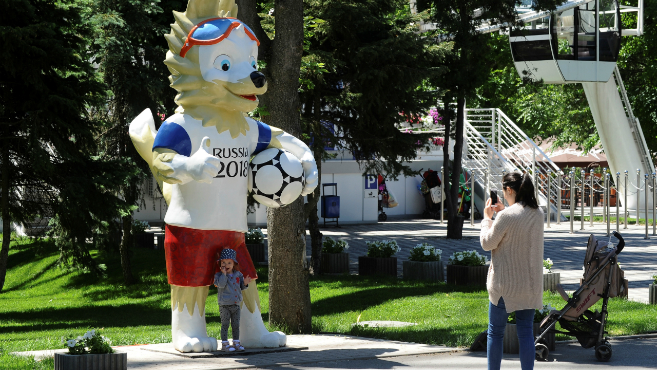 "Described as a wolf who radiates fun, charm and confidence by FIFA's official site, the wolf named Zabivaka is chosen as the official mascot for the 2018 FIFA World Cup Russia. The name 'Zabivaka' which translates as ""the one who scores"" in Russian and was designed by a student designer Ekaterina Bocharova. Chosen via a poll that was held online, Zabivaka received 53 per cent of the votes cast. We can expect to see Zabivaka interacting with fans in and around the stadium during the matches in Russia."