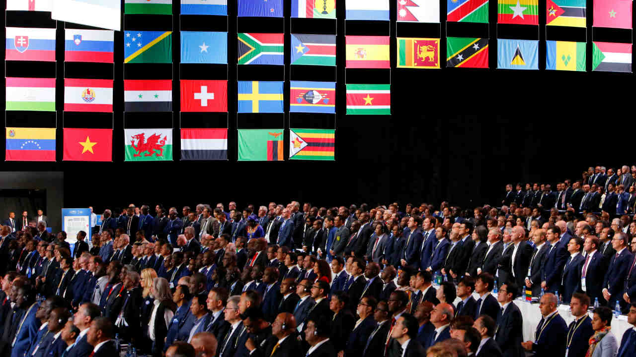 Participants of the 68th FIFA Congress observe a minute of silence in memory of delegates, who recently passed away, in Moscow, Russia. (Image: Reuters)