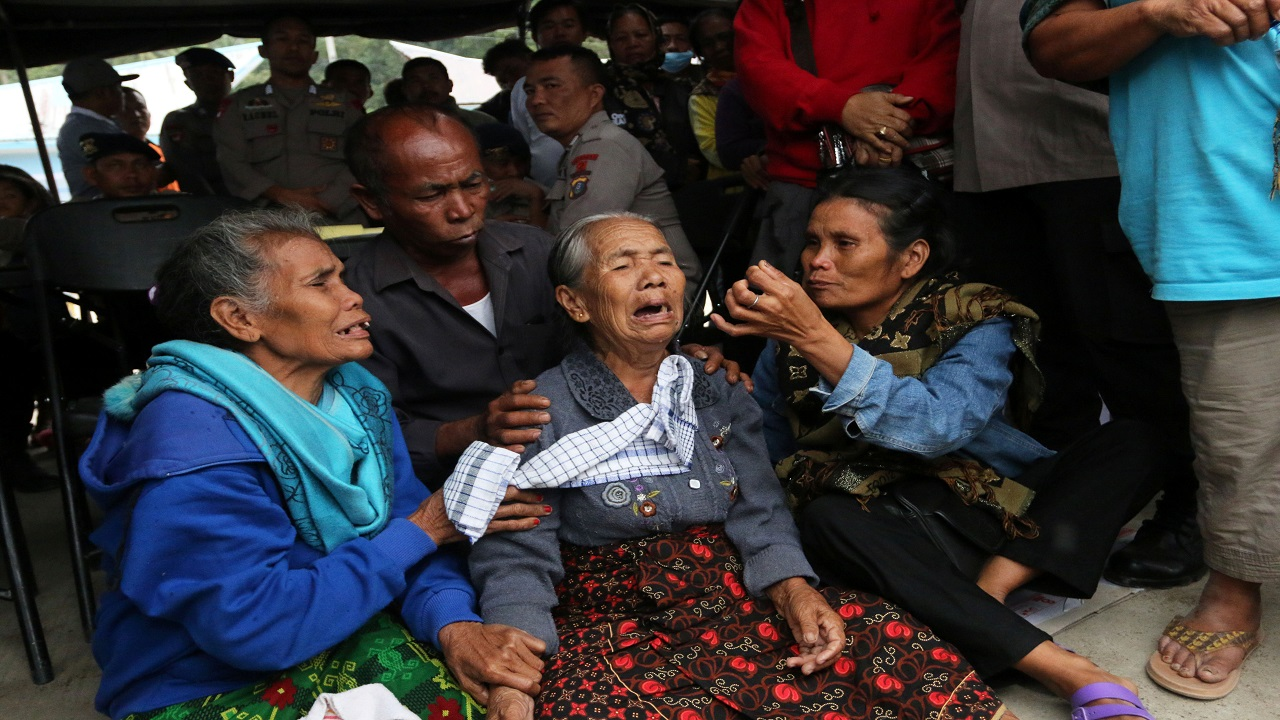 Relatives of missing passengers from a ferry accident on Lake Toba wait for news about their kin at a command post at Tigaras port in Simalungun, North Sumatra, Indonesia. (Image: Reuters)