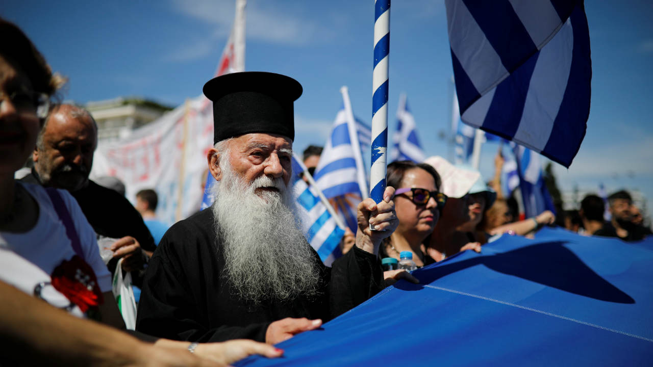 A Greek Orthodox priest takes part in a demonstration against the agreement reached by Greece and Macedonia to resolve a dispute over the former Yugoslav republic's name, in Athens. (Image: Reuters)