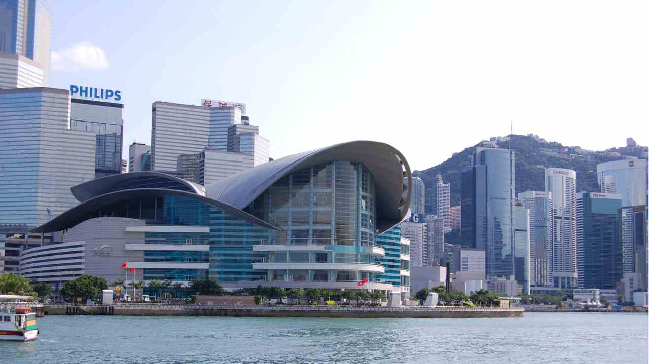 Hong Kong | The Asian financial hub will add 22 billionaires by 2027. Total wealth held in the city-state amounts to $1.3 trillion. Hong Kong is considered to be the gateway between Europe and Asia and it is home to the 7th largest stock exchange in the world. (The Hong Kong Convention and Exhibition Centre- Wikimedia Commons)