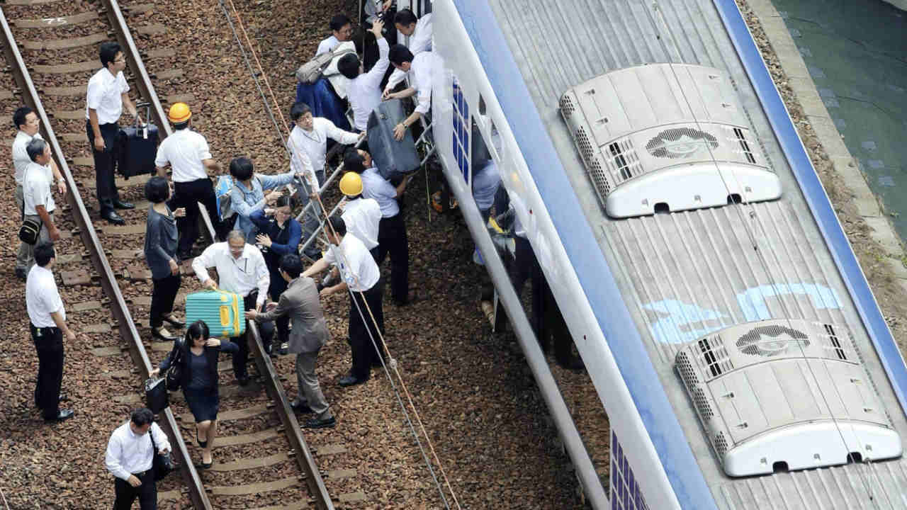 Passengers get off a train which operation was suspended after an earthquake in Takatsuki, Osaka prefecture, western Japan. (Image: Reuters)
