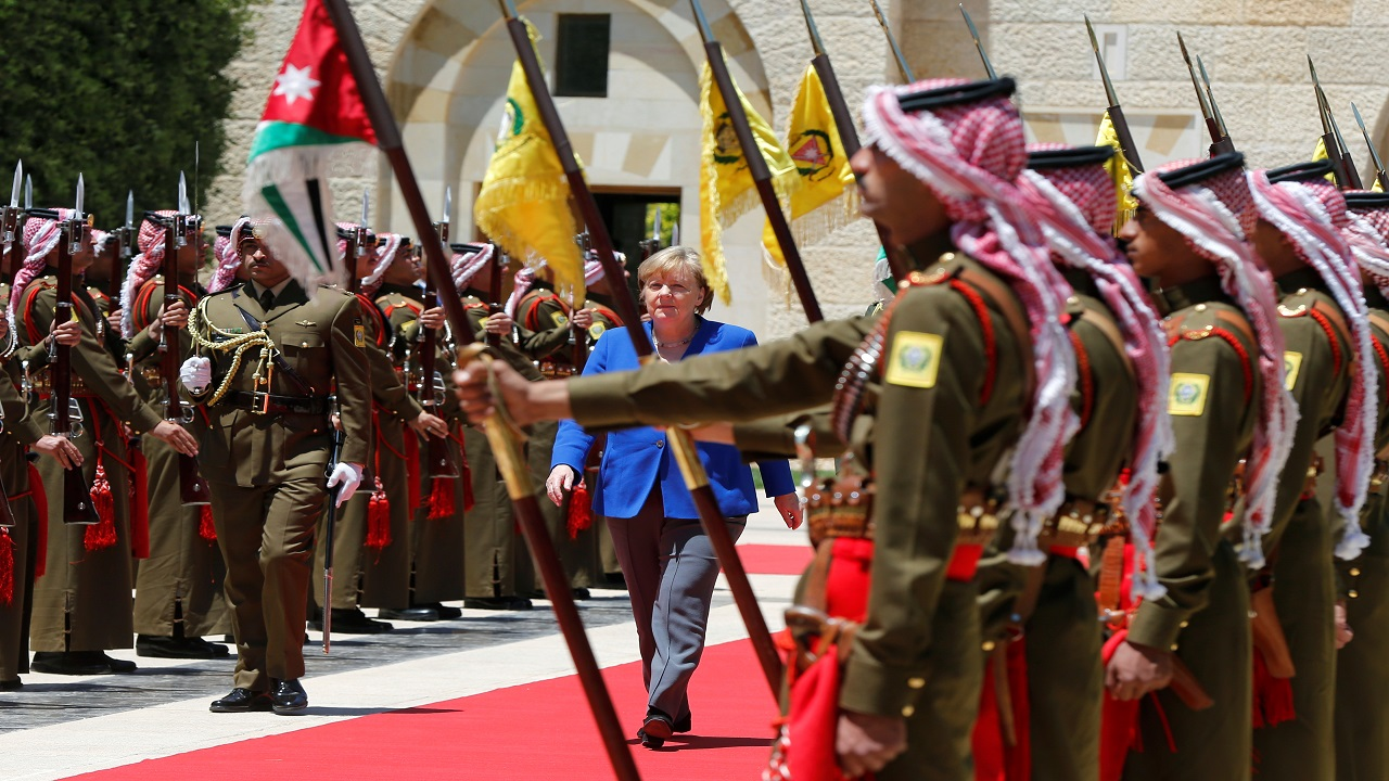 German Chancellor Angela Merkel inspects guard of honour upon her arrival at the Royal Palace in Amman, Jordan. (Image: Reuters)