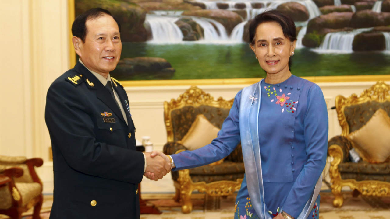 Myanmar's leader Aung San Suu Kyi, right, shakes hands with China's Defense Minister Lt. Gen. Wei Fenghe, left, during their meeting at the President House in Naypyitaw, Myanmar. (Image: AP/PTI)