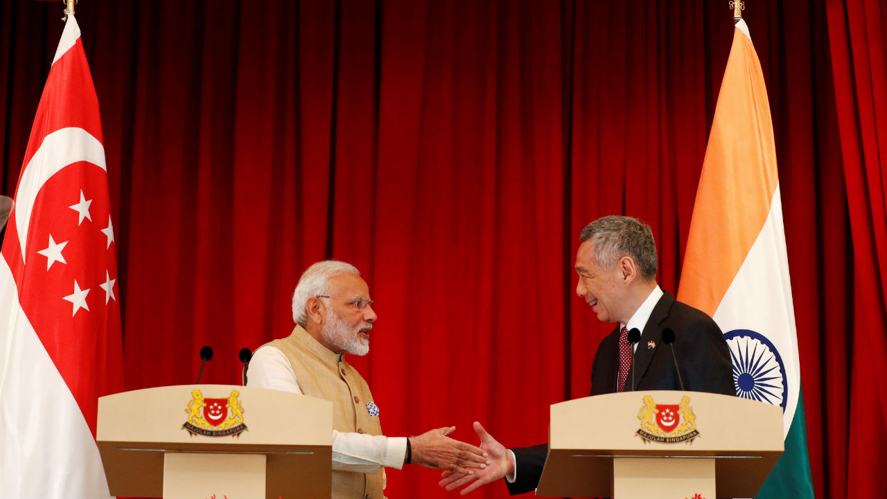 Prime Minister Narendra Modi shakes hands with Singapore's Prime Minister Lee Hsien Loong at the Istana. (Photo: Reuters)
