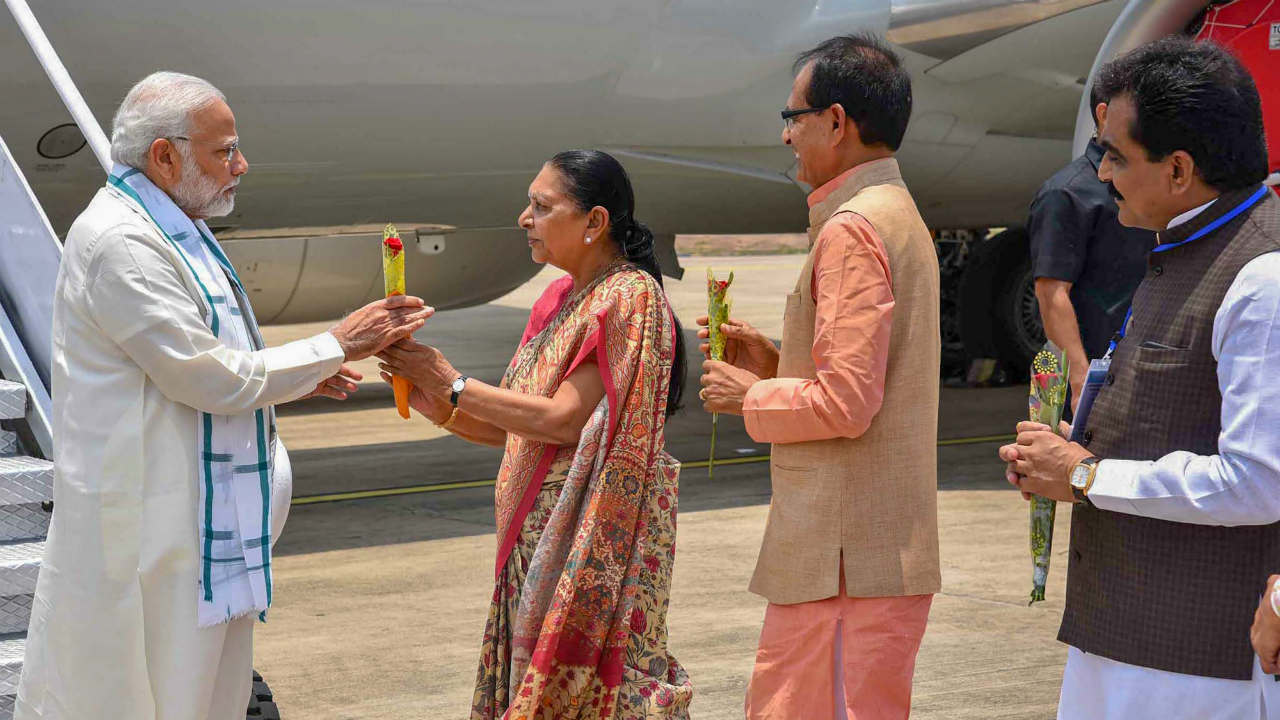 Prime Minister Narendra Modi being welcomed by Madhya Pradesh Governor Anandi Ben Patel, Chief Minister Shivraj Singh Chouhan and State BJP President Rakesh Singh on his arrival at Bhopal Airport. (Photo: PTI)