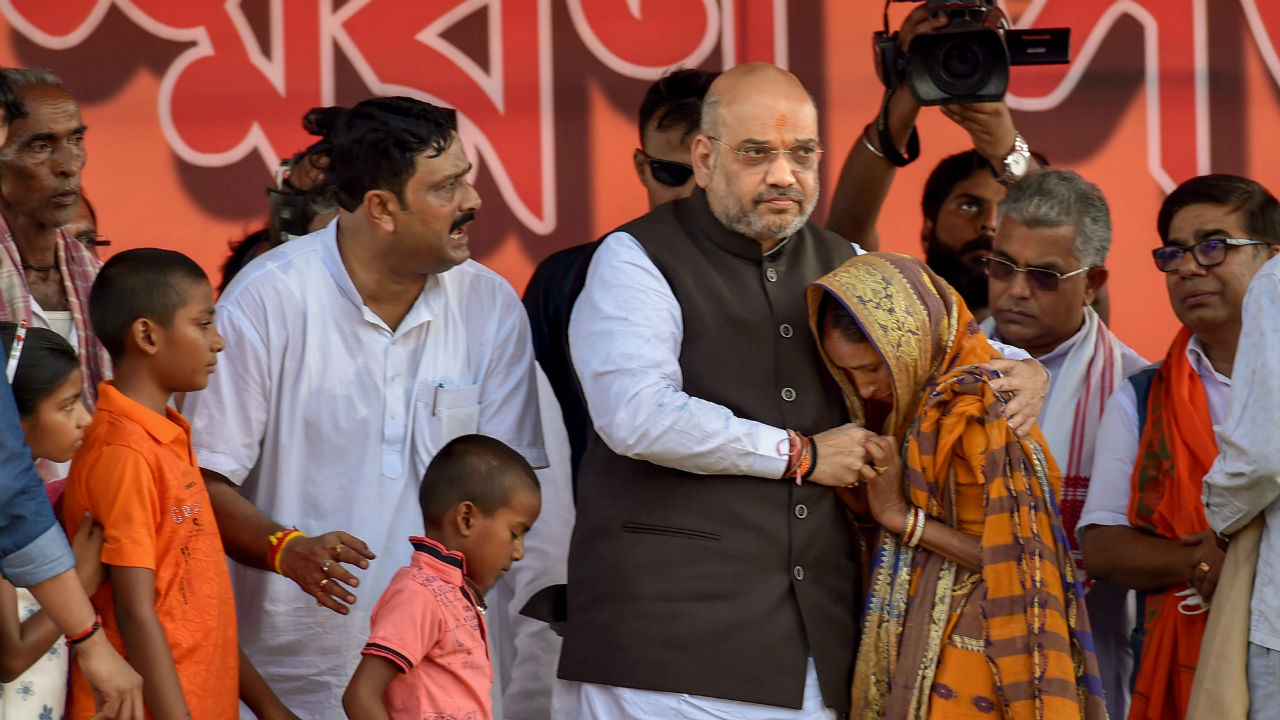 BJP National President Amit Shah meets with the family members of Trilochan Mahato and Dulal Kumar, who were killed after the panchayat election, in Purulia district of West Bengal.(PTI)