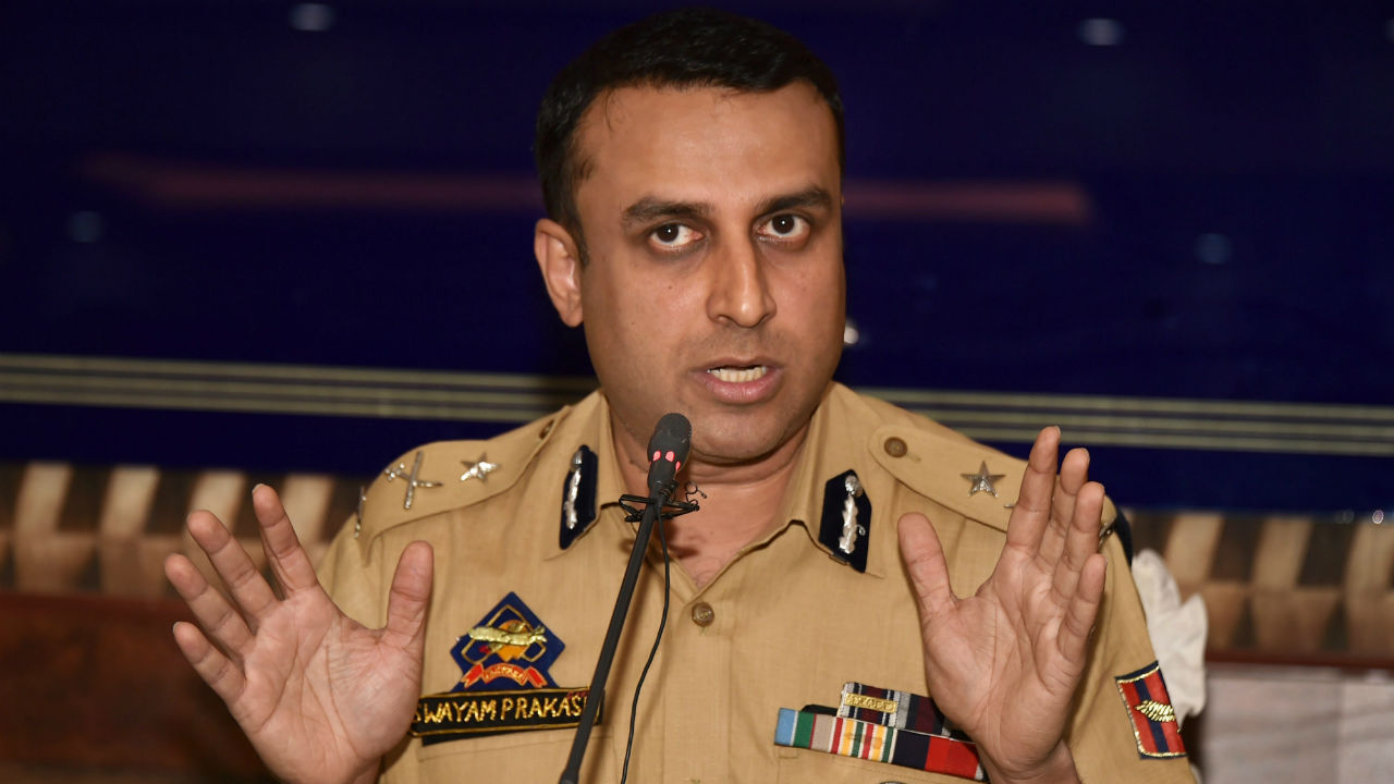 Inspector General of Police SP Pani addresses a press conference to release the identity of four LeT cadre Sheikh Sajad Gul, Azad Ahmad Malik, Muzafar Ahmad Bhat, and Naveed Jatt who are allegedly involved in the killing of Kashmiri journalist Shujaat Bukhari, in Srinagar. (PTI)
