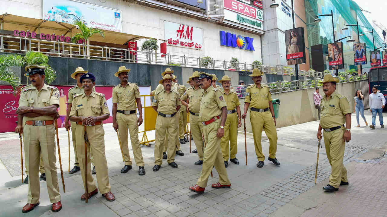 Police personnel stand guard at a multiplex on the ifrst day of Rajnikanth's 'Kaala' release, in Bengaluru. Pro-Kannada outfits have threatened to stall release of the movie over the actor's reported remarks on the Cauvery row and warned of large-scale protests if the movie was released.(PTI)