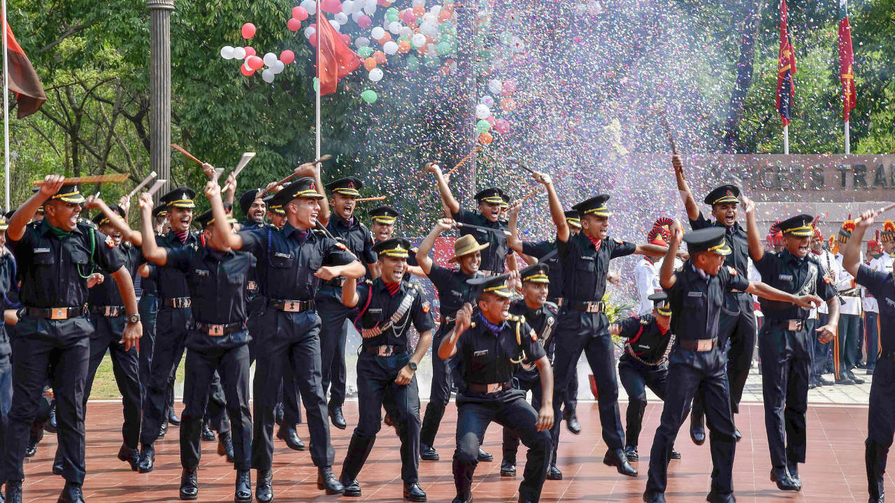 Gentlemen cadets celebrate after their passing out parade at Officers Training Academy Gaya. (Image: PTI Photo)