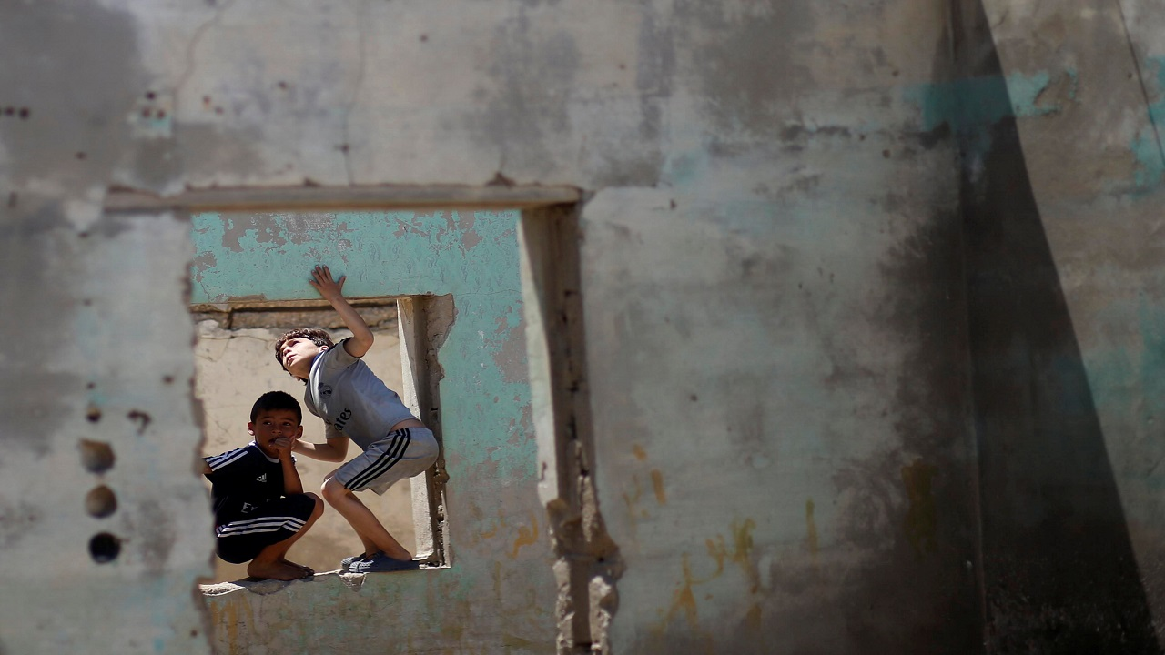 Palestinian boys play in an abandoned house at the Al-Shati refugee camp in Gaza City, Palestine. (Image: Reuters)