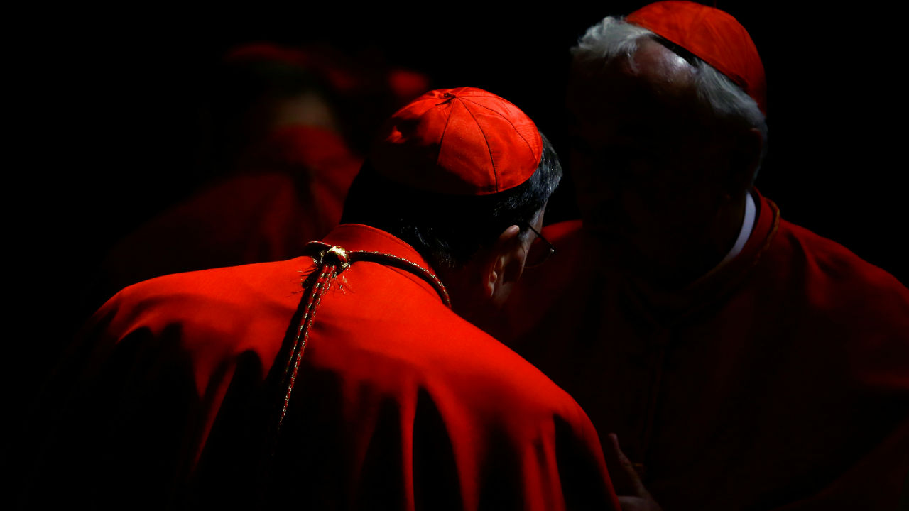 Cardinals talk before a consistory ceremony to install 14 new cardinals in Saint Peter's Basilica at the Vatican. (REUTERS)