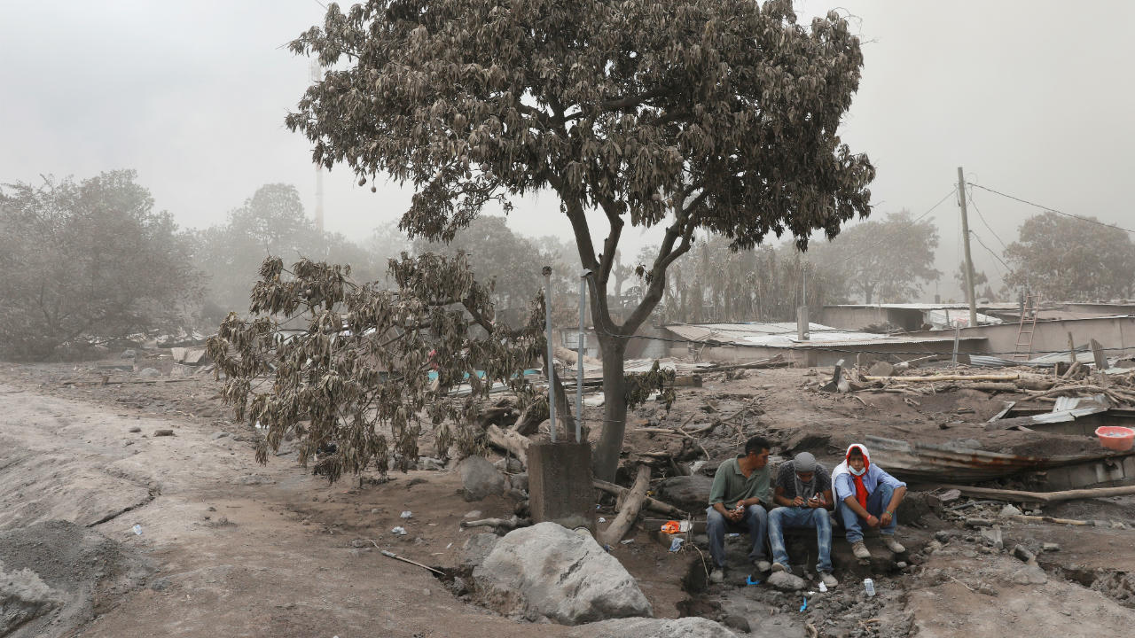 Residents pause during a search at an area affected by the eruption of Fuego volcano in San Miguel Los Lotes in Escuintla, Guatemala. (Image: Reuters)