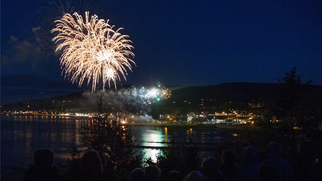 Residents watch fireworks explode over their town following the G7 Summit in the Charlevoix town of La Malbaie, Quebec, Canada. (Image: Reuters)