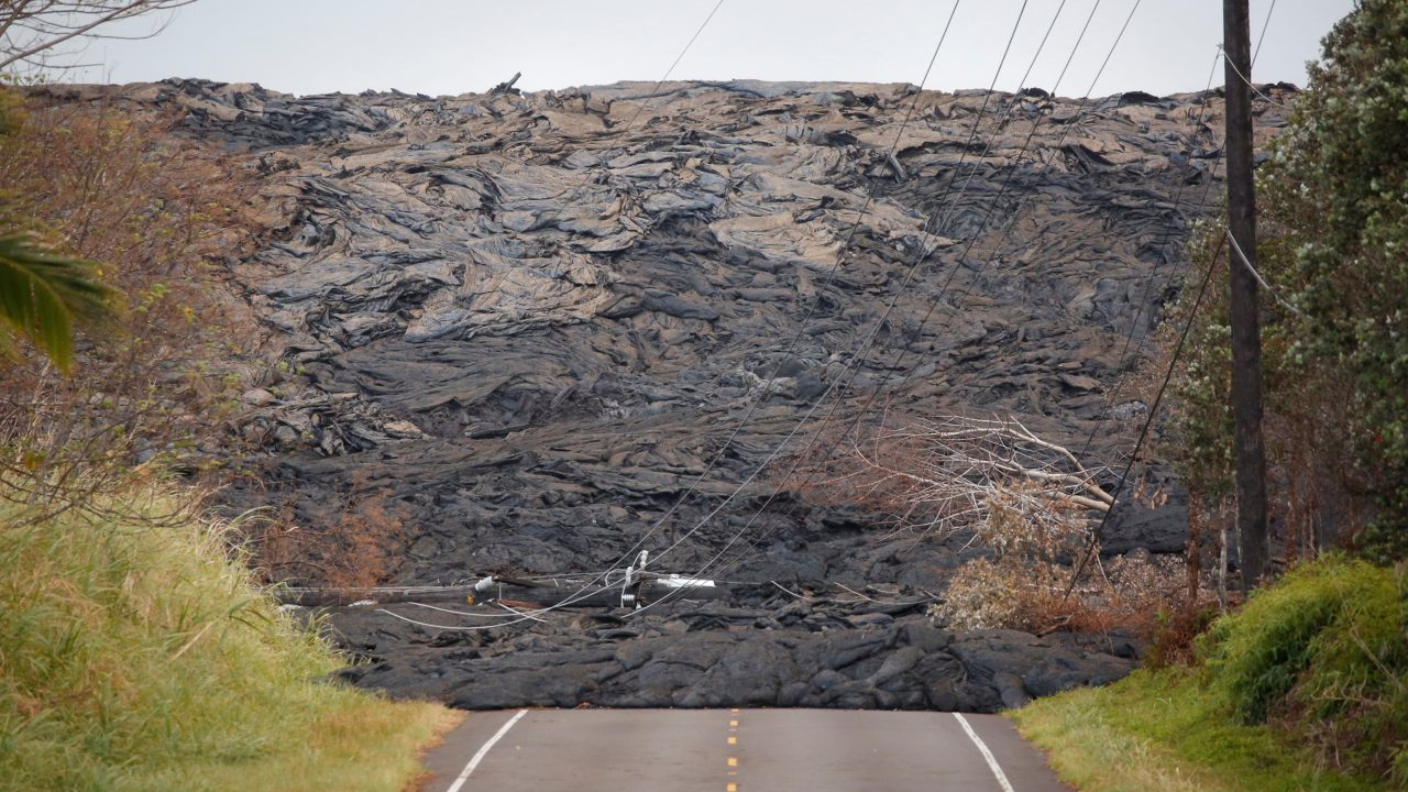 Lava covers a road on the outskirts of Pahoa during ongoing eruptions of the Kilauea Volcano in Hawaii, US. (Image: Reuters)