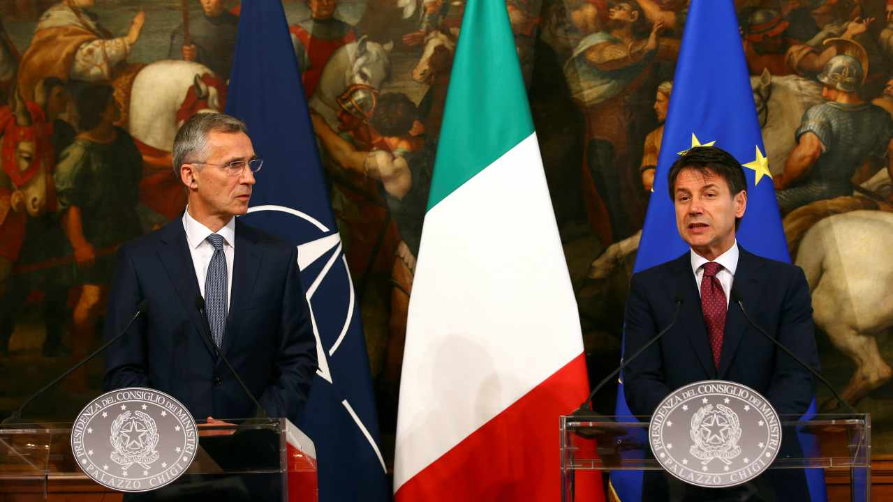 Italy's Prime Minister Giuseppe Conte speaks next to NATO Secretary-General Jens Stoltenberg during a media conference at Chigi palace in Rome, Italy. (Reuters)