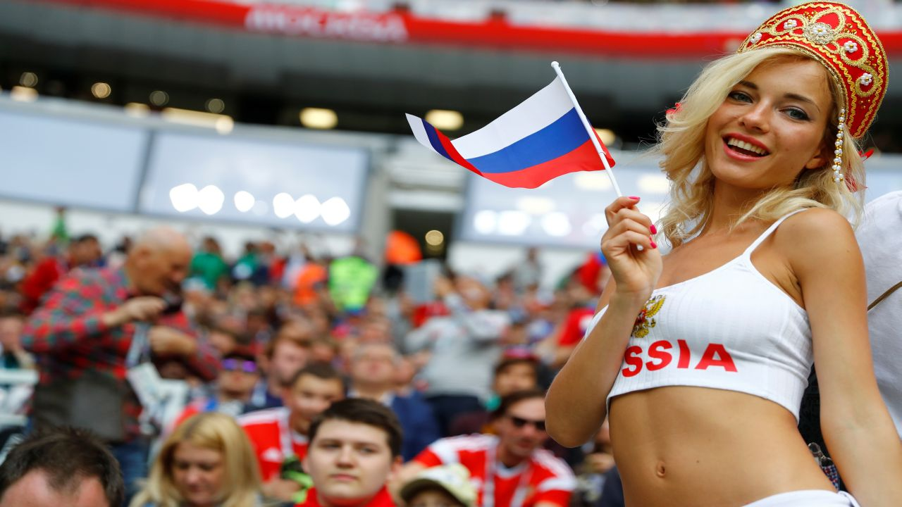 A Russian fan poses for the camera as the opening ceremony proceeds. (Image: Reuters)