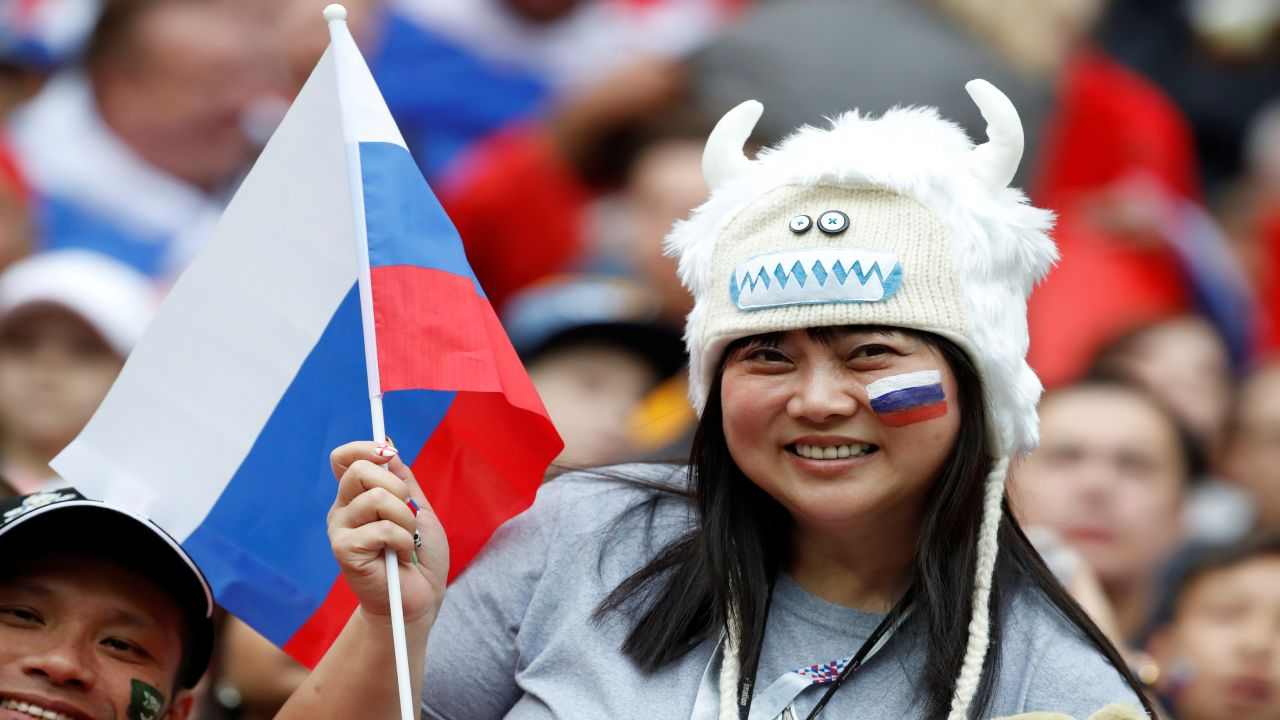 A fan waves a Russian flag at the opening ceremony. (Image: Reuters)