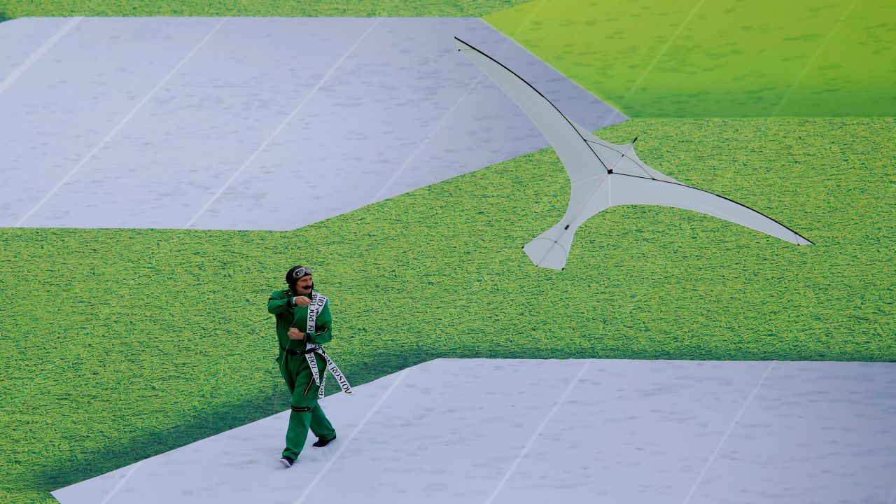 A performer flies a bird shaped kite during the opening ceremony. (Image: Reuters)