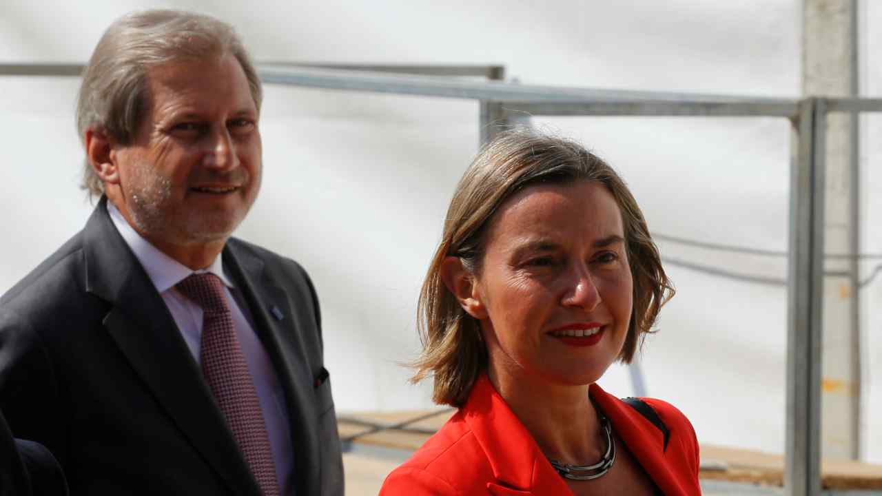 EU High Representative for Foreign Affairs Federica Mogherini and European Commissioner for European Neighbourhood Policy and Enlargement Negotiations Johannes Hahn arrive before the signing of an accord to settle a long dispute over the former Yugoslav republic Macedonia's name in the village of Psarades, in Prespes, Greece. (Reuters)