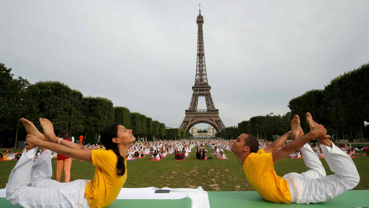People gather for an open-air yoga session near the Eiffel tower in Paris, France. (Reuters)