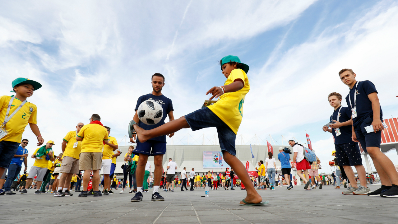 Brazil fans enjoying a little football before the match.