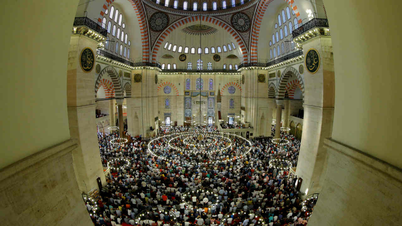 Worshippers pray during the first day celebration of Eid al Fitr at Suleymaniye Mosque in Istanbul, Turkey. (Image: Reuters)