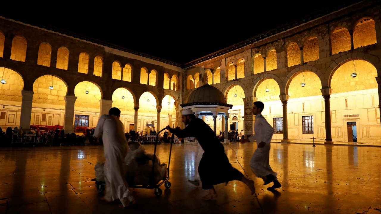 A man pushes a cart at the Umayyad mosque on Laylat al-Qadr during the last week of the Muslim fasting month of Ramadan, in Damascus, Syria. (Photo: Reuters)