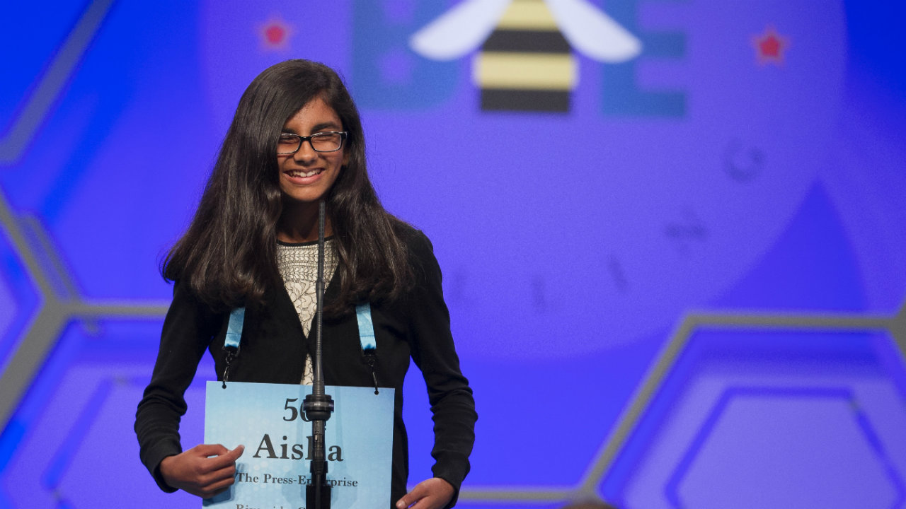 Aisha Randhawa, 12, from California spells her word correctly during the evening finals of the Scripps National Spelling Bee. (Photo: AP)