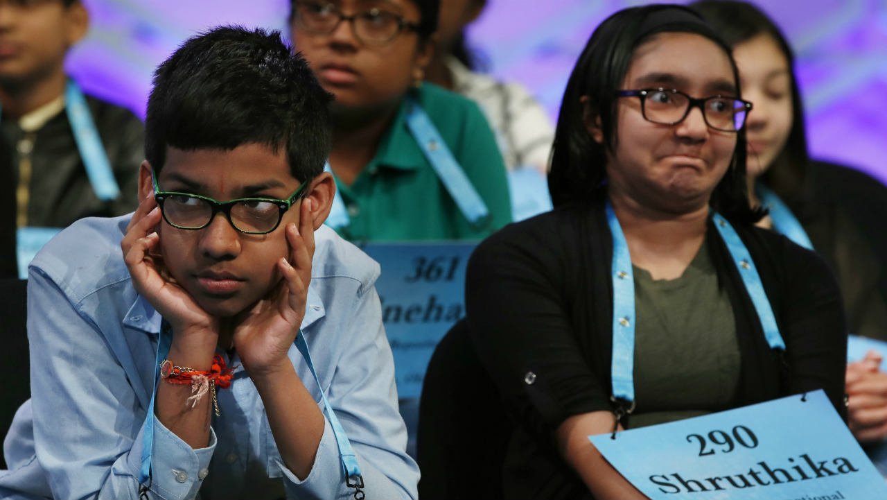 Navneeth Murali, 12, and Shruthika Padhy, 12, react during competition in the spelling contest. (Photo: AP)
