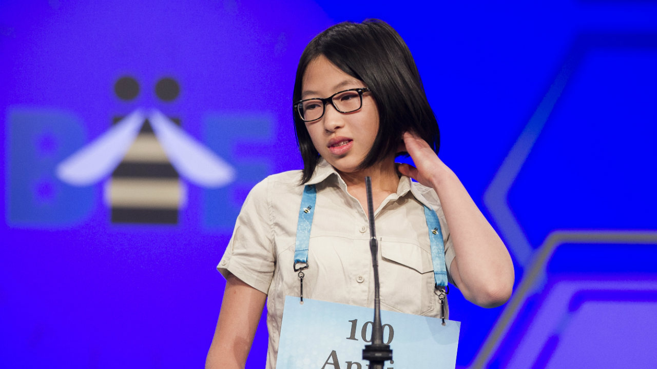 "Annie Huang, 12, from ""Surrey, British Columbia"", Canada, spells her word during the 2nd Round. (Photo: AP)"