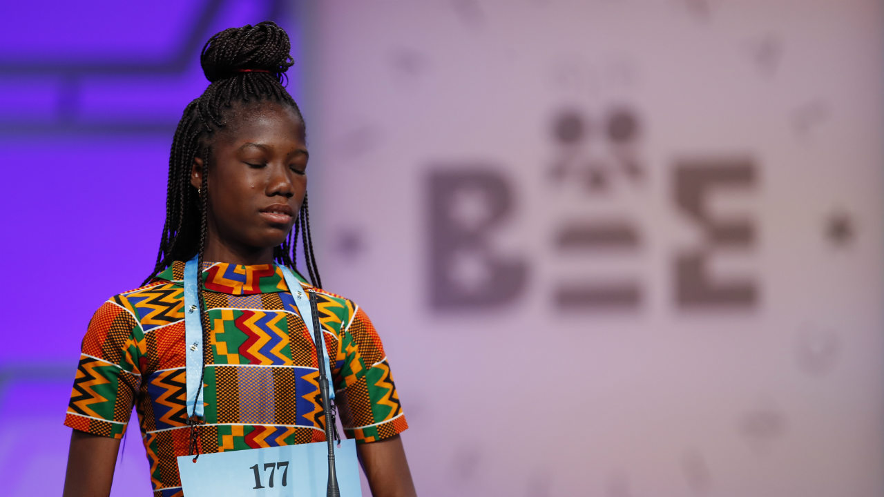 Shifa Amankwa-Gabbey, 12, from Ghana, reacts after spelling her word incorrectly during the 3rd Round. (Photo: AP)