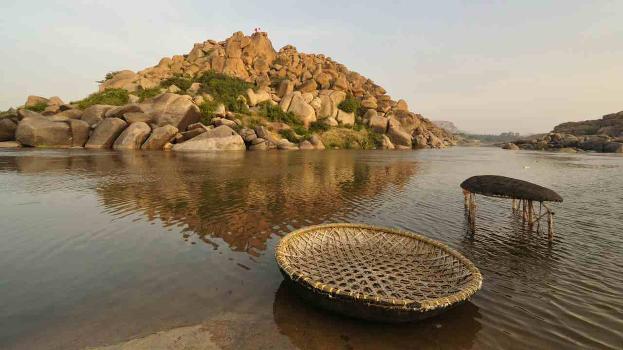 Karnataka | Score: 56 | The state which recently went through assembly elections ranks overall fifth according to NITI Aayog's report. It also improved upon its performance slightly to climb in the rankings. (Couple of coracles (round-shaped boats) at Tungabhadra river near Hampi; Wikimedia Commons)