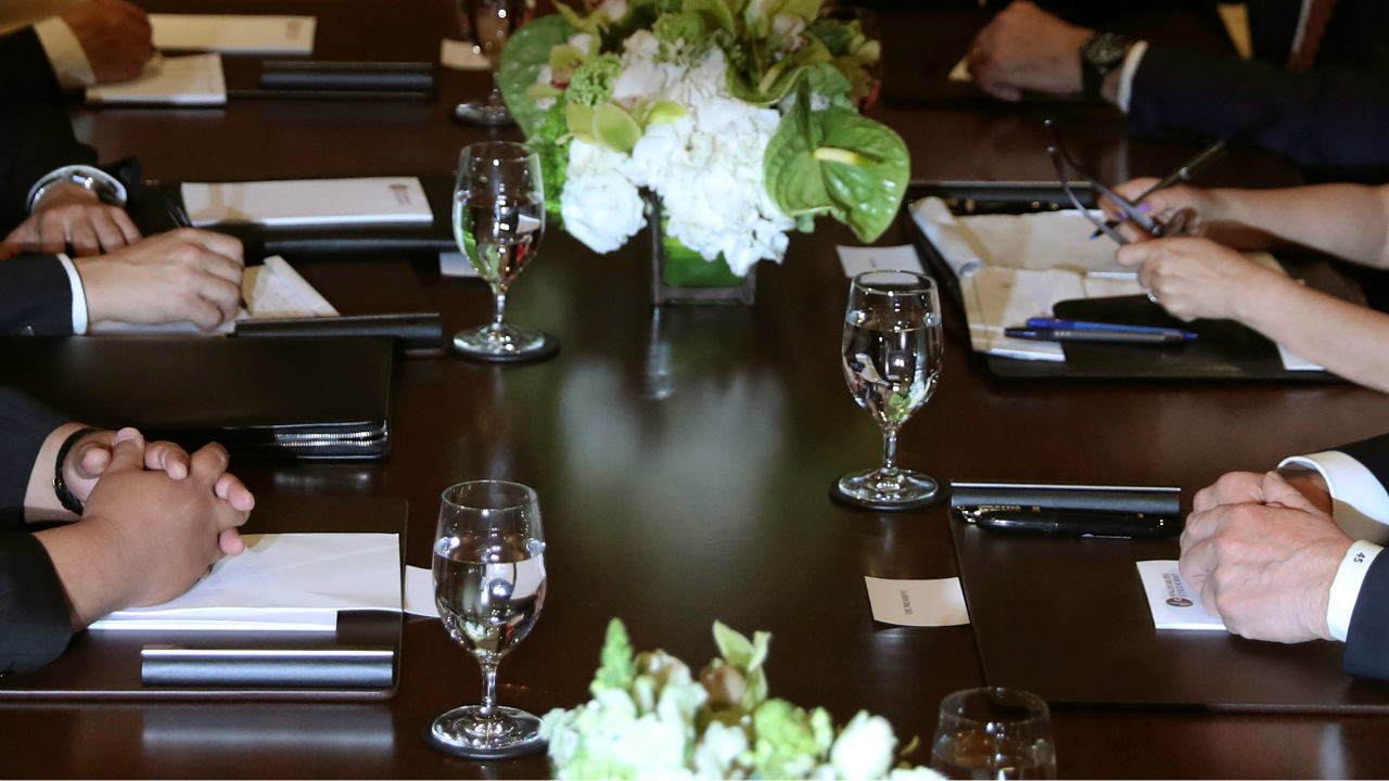 Donald Trump and Kim Jong Un sit before their expanded bilateral meeting at the Capella Hotel . (Photo: Reuters)