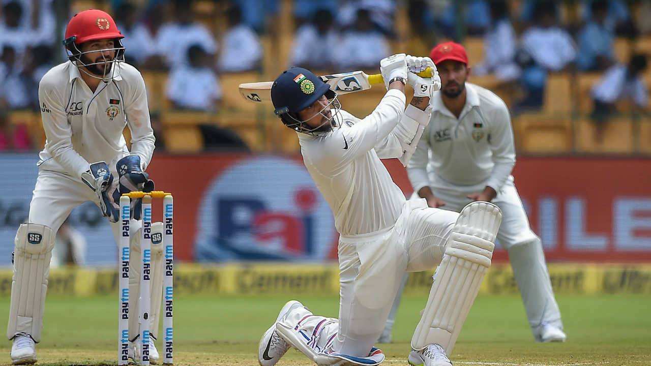 Indian cricketer Umesh Yadav plays a shot during the second day of the one-off test match against Afghanistan at M Chinnaswamy Stadium, in Bengaluru. (Image: PTI)
