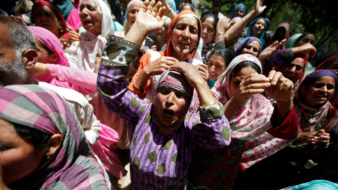 Relatives mourn as they watch the body of Ghulam Hassan Wagay, a policeman who according to local media was killed in a militant attack in south Kashmir's Pulwama district, during his funeral at Kashmir's Baramulla district. (Image: Reuters)