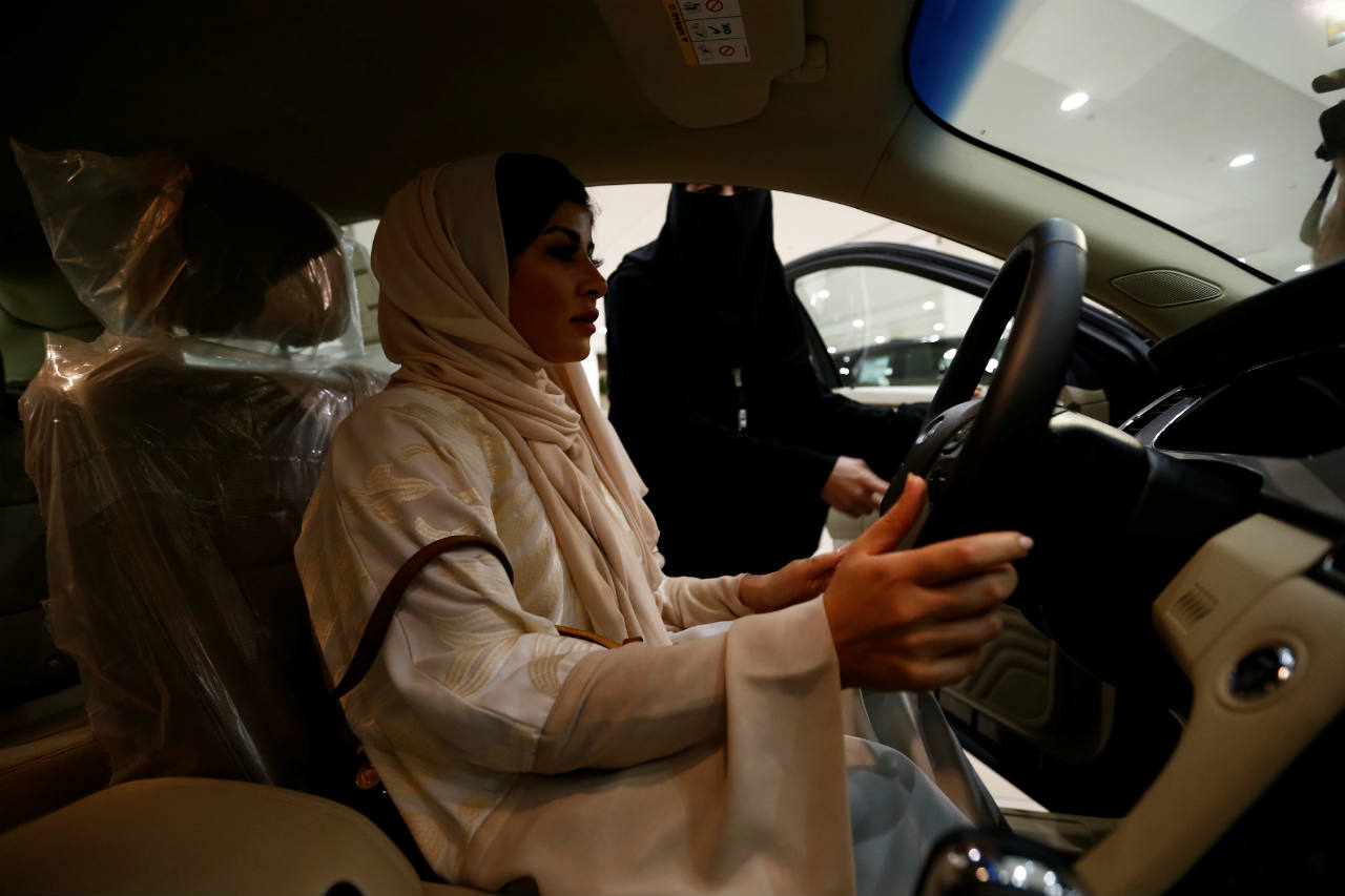 Saudi female surgeon Fatima al-Nasseralah checks her future car at Riyadh's showroom ahead of being able to practice the right to drive in the conservative kingdom later this month. (Image: Reuters)