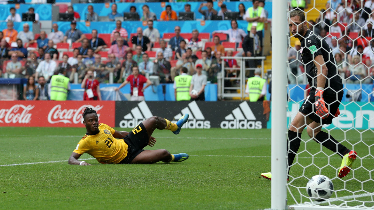 Belgium's Michy Batshuayi slides in to score their fifth goal.
