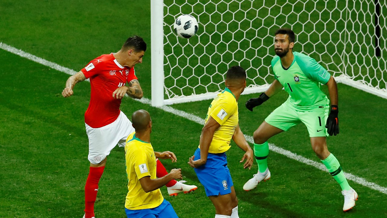 Switzerland's Steven Zuber scores their first goal heading the ball past Brazilian keeper Alisson.