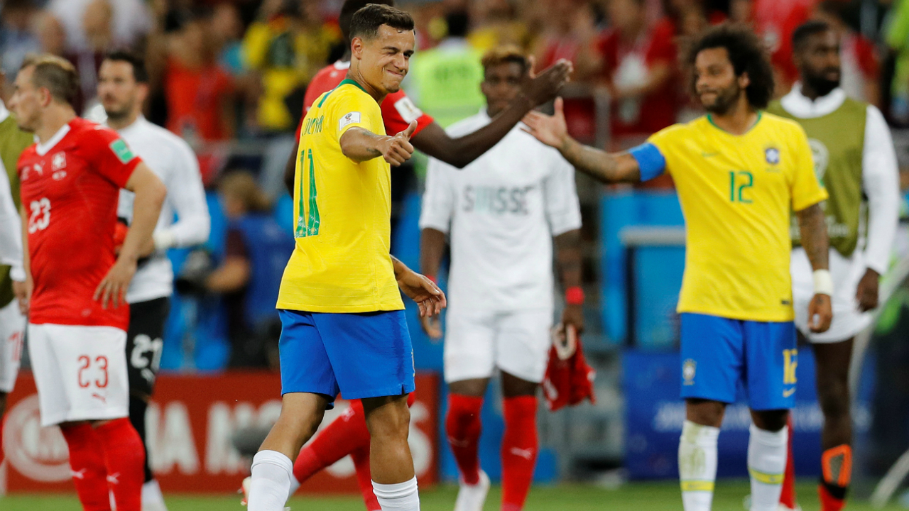 Brazil's Philippe Coutinho gestures a thumbs up after the match.